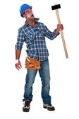 Injured workman with mallet in hand — Stock Photo
