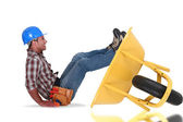Mason falling from a wheelbarrow — Stock Photo