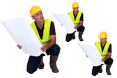 Multiple shot on foreman with plans kneeling — Stock Photo