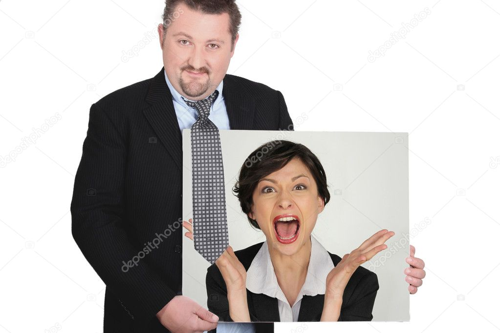 Businessman with a picture of a woman shouting  Stock Photo #9969740