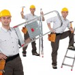 Handyman with a ladder — Stock Photo