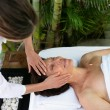 Woman enjoying a massage — Stock Photo