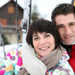 Stock Photo: Couple in front of a ski cabin