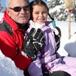 Grandfather and little girl in ski holidays — Stock Photo