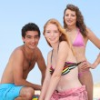 Three teenagers on the beach — Foto de stock #9970726