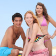 Foto Stock: Three teenagers on the beach