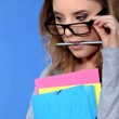 Geeky student holding folders — Stock Photo #9971273