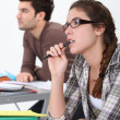 Stock Photo: Two students concentrating in class