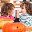 Children carving Halloween pumpkins — Stock Photo