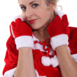 Stock Photo: Blond womwearing seductive Santcostume