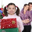 Girl and parents with Christmas presents — ストック写真
