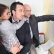 Couple and child in architect's office — Stock Photo #9971873