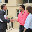 Estate agent shaking customers hand — Stockfoto