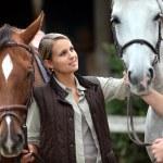 Couple stood with horse — Stock Photo #9972313