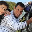 Stock Photo: Father and son working on motorbike
