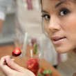 Woman eating strawberries — Stockfoto #9972657
