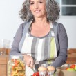 Mature woman cooking — Stock Photo