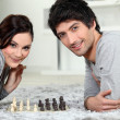 Stock Photo: Mand womplaying chess