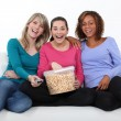 Stock Photo: Friends laughing and eating popcorn