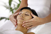 Masseuse giving face massage — Stock Photo