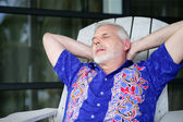 Senior relaxing in the yard — Stock Photo