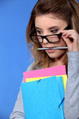 Geeky student holding folders — Stock Photo