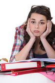 Bored student with a pile of homework — Stok fotoğraf