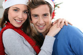 Portrait of a young couple at Christmas — Stok fotoğraf