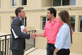 Estate agent shaking customers hand — Stock Photo