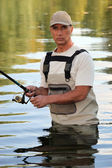 Man fishing in a river — Stock Photo