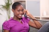 Woman at home on the phone — Stock Photo