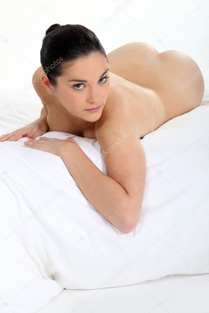 Woman lying naked on bed  Stock Photo #9970309