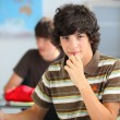 Teenage student in a classroom — Stock Photo