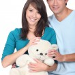 Young couple with a teddy bear — Stock Photo #9992368