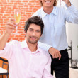 Stock Photo: Friends toasting with champagne