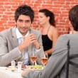 Two businessmen eating in a restaurant — Stock Photo