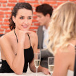 Two female friends having meal in posh restaurant — Stock Photo #9992843