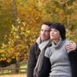 Couple enjoying autumnal walk in the park — Stock Photo #9993731