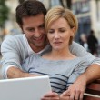 Stock Photo: A couple seated on a bench