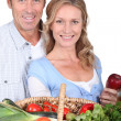 Husband and wife with vegetable basket. — Stock Photo #9994083