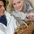 Couple with basket of chestnuts — Stock Photo #9994420
