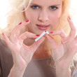 Blond woman giving up smoking — Stock Photo