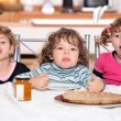 Stock Photo: Children snacking