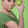 Woman holding green apple against face — Stock Photo #9999255