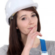 Female laborer with cunning plan — Stock Photo #9999552