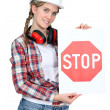 Woman holding stop sign - Stock Photo