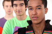 Three male students posing in a line — Stock Photo