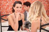Two female friends having meal in posh restaurant — Stock Photo