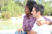 Couple by the waterside — Stock Photo