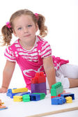 Young girl playing with blocks — Stock Photo